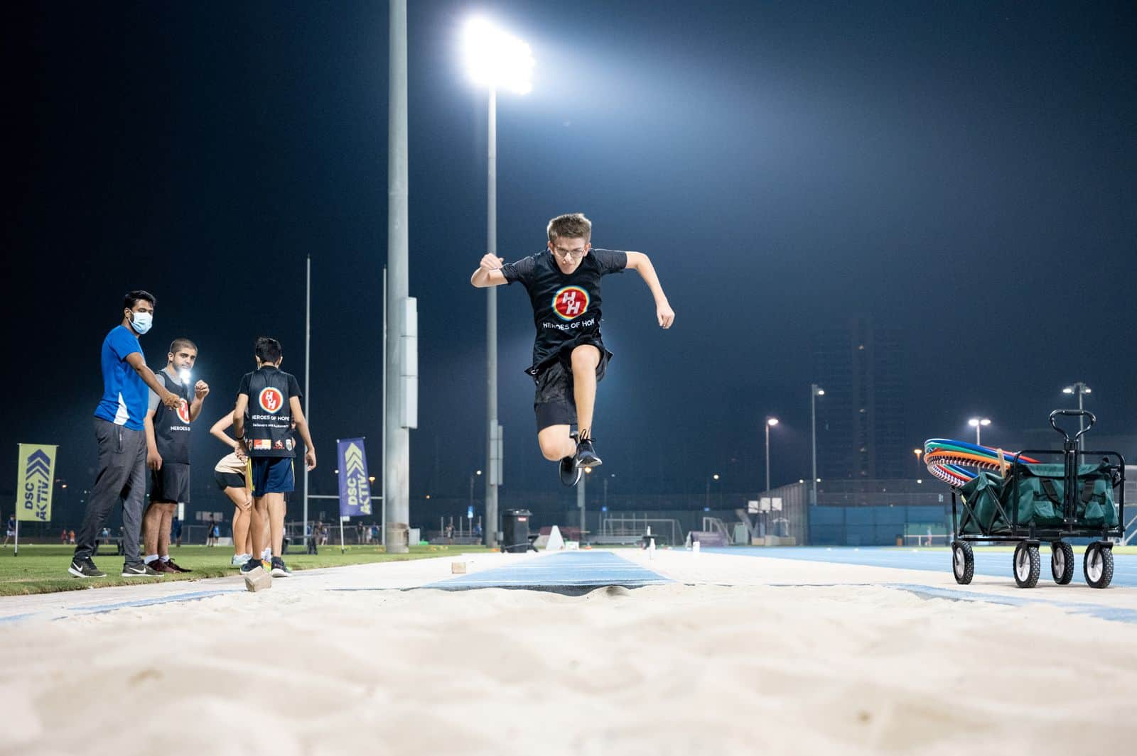 Heroes of Hope Athlete Jumping in sand